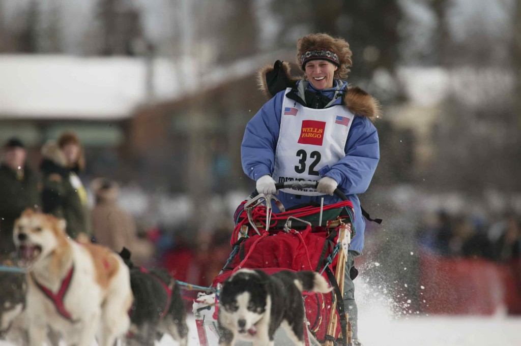 Dog Musher Debbie Moderow leaves the shoot for the 1000 mile 2003 Iditarod sled dog race from Fairbanks to Nome, Alaska . Lack of snow along the normal trail route further south forced the relocation of the restart on the Chena River in Fairbanks.